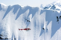 Alpine Helicopters flying by couloir