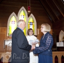 Wedding couple say vows in church photo