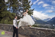Groom help bride walk on wall_pamdoyle w