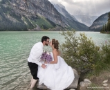 Kiss groom in Lake Louise_pamdoyle ww