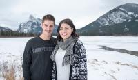 Young couple frozen Vermillion Lakes