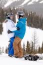 Snowboarders hug after ski wedding
