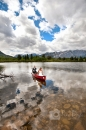 Married couple canoe on beautiful lake