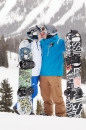 Snowboarders kiss at wedding