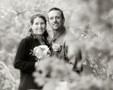 Black and white photo of couple in woods