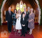 Wedding group photo at altar in church