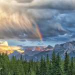 Rainbow points to Canmore amongst storm clouds